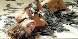 naked girl surrounded with money