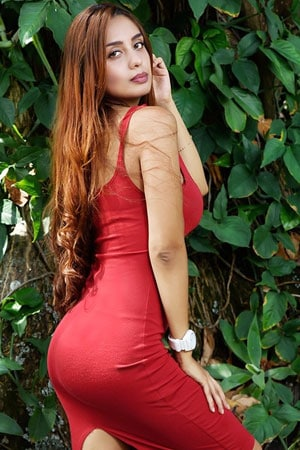 petite and sweet Colombian beauty in red dress