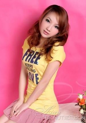 pretty Chinese girl wearing yellow shirt