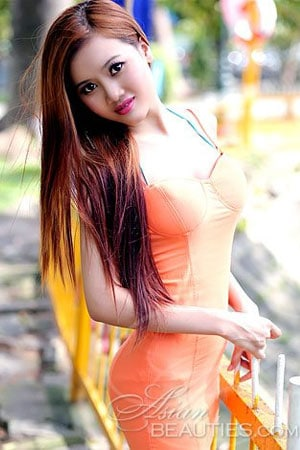 pretty Vietnamese babe in an orange dress
