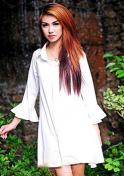 provocative Thai girl in white long sleeves dress