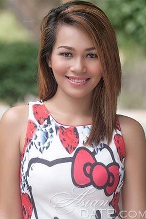simple Filipina woman flashing a smile