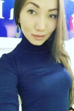 single Kazakh woman in blue turtleneck