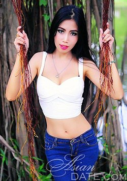slim-Thailand babe making a sexy pose beside the tree