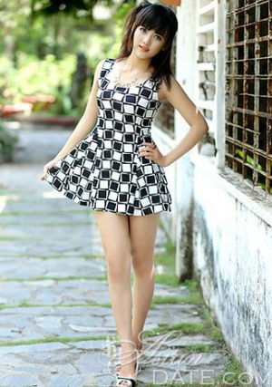 slinky Vietnamese babe in a short black and white dress