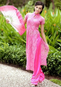 tantalizing Vietnam girl in a pink dress holding a pink fan
