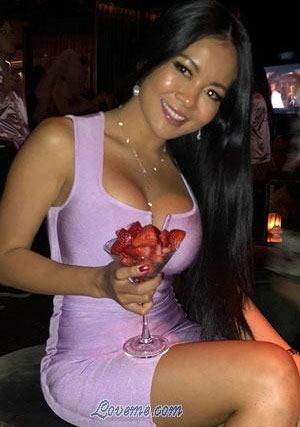 Thai babe holding a glass of fruit