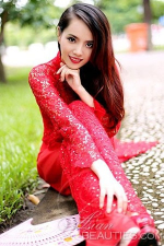 Vietnamese babe in a red traditional dress