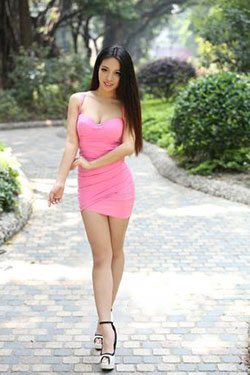 voluptuous Chinese babe in a sexy pink dress