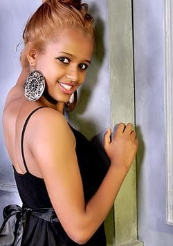young African woman wearing a simple black dress