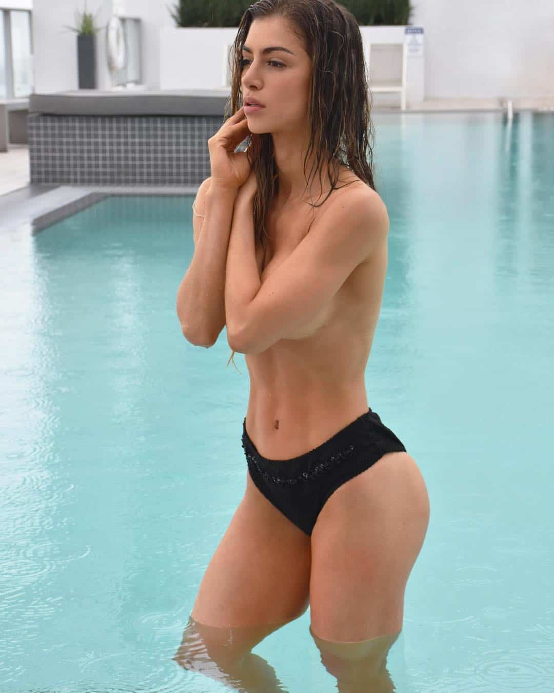 Anllela Sagra topless at the pool