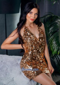 attractive Ukrainian doctor in a shiny gold dress