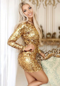 blonde Ukrainian girl in a gold shiny dress