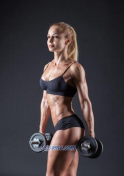 blonde Ukrainian woman lifting weights
