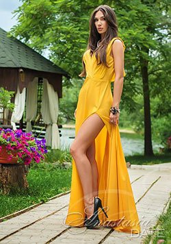 charming lady from Ukraine in a sexy yellow gown