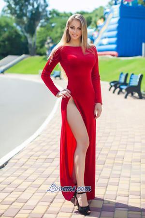 cute blonde fitness buff in long red dress