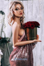 hot Russian lady holding a vase of flowers