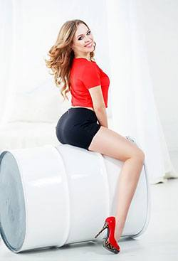 hot Ukrainian lady in red sitting on a drum