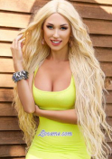 matured Ukrainian blonde wearing a yellow dress