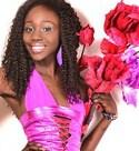 sweet Nigerian babe holding flowers