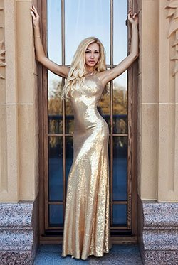 tall Ukraine babe in a shiny gold dress