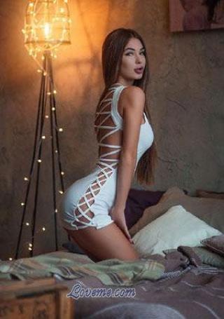 teasing Ukrainian brunette on the bed