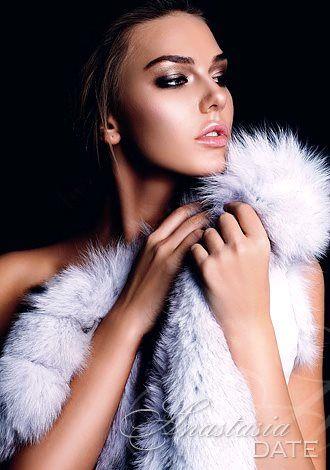 Ukraine babe holding a fur boa