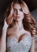 Ukrainian model in a shiny silver dress