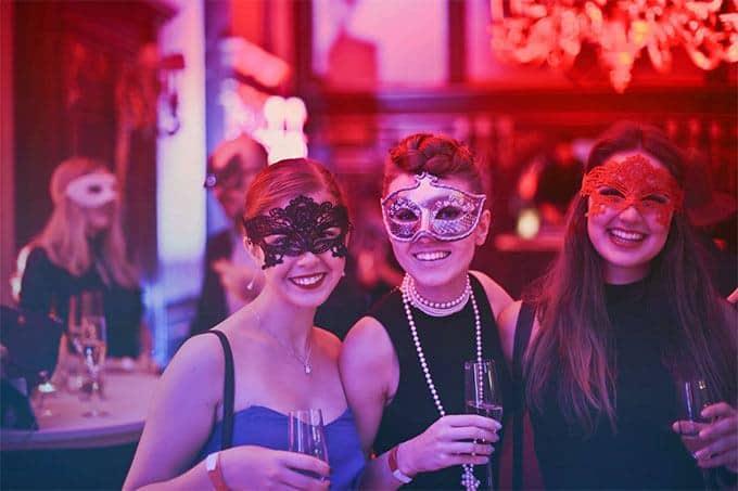 women in a masquerade bar