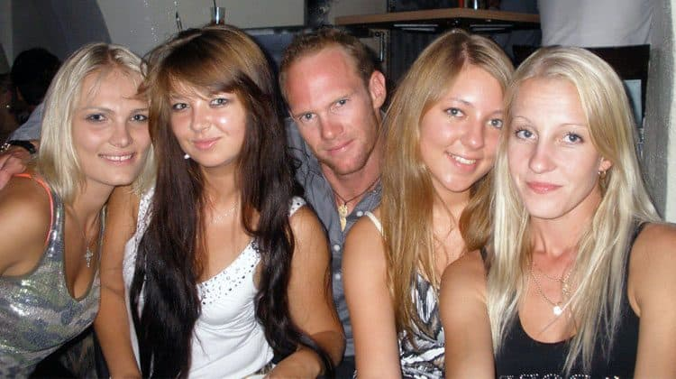 a guy surrounded with gorgeous Estonian girls