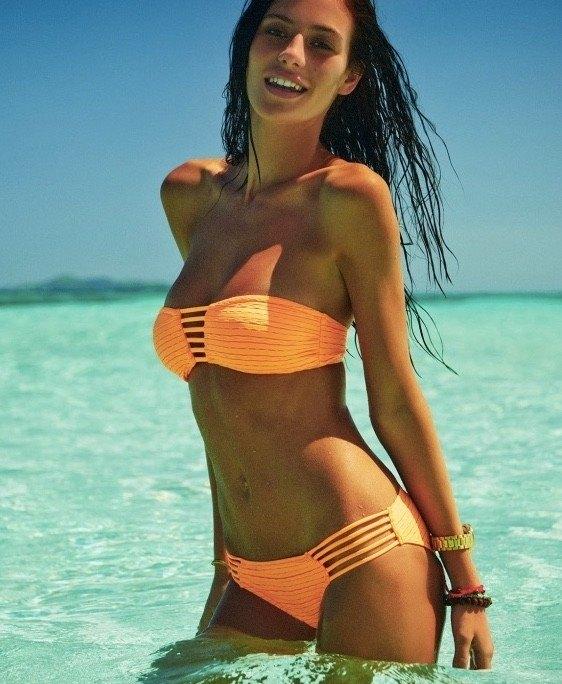 Alejandra Guilmant glowing in orange bikini