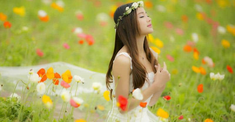 cool Chinese girl in the field of flowers