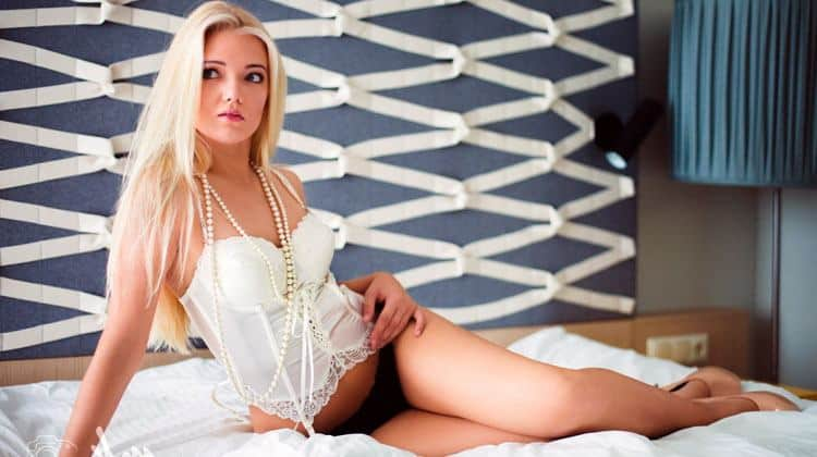hot Estonian blonde woman sexy on the bed