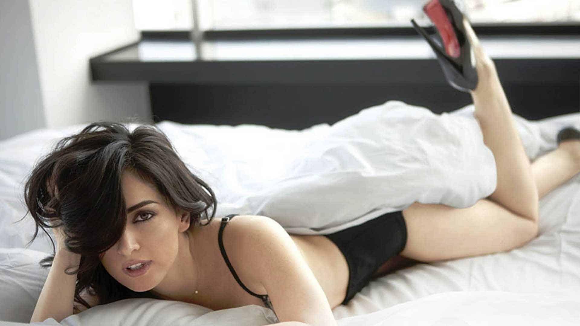 Ana Claudia Talancon on the bed