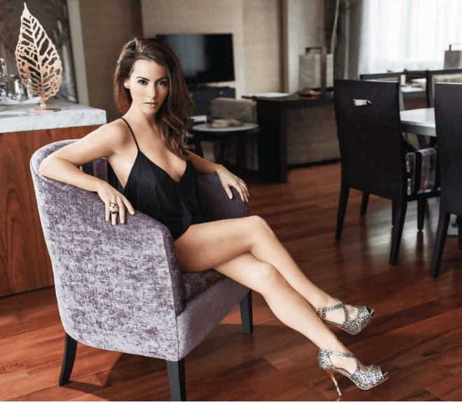 Claudia Lizaldi at the couch