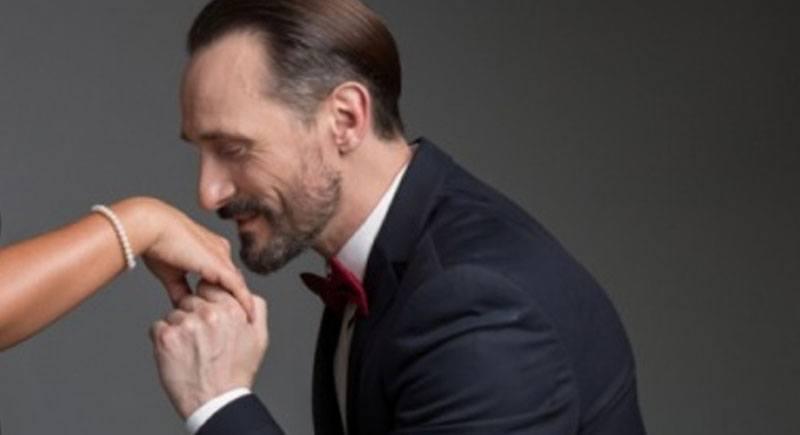gentleman kissing a hand