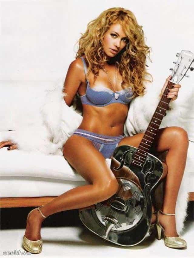 Paulina Rubio holding a guitar