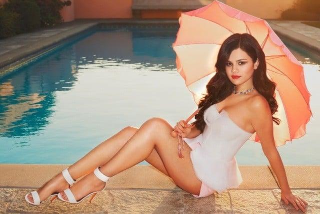 Selena Gomez beside the pool