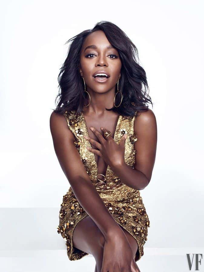 Aja Naomi King in golden dress
