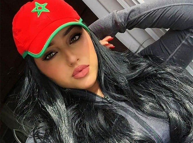 beautiful Moroccan woman wearing a cap with flag symbol