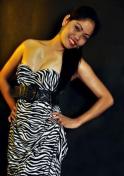 Filipina girl wearing a zebra printed dress