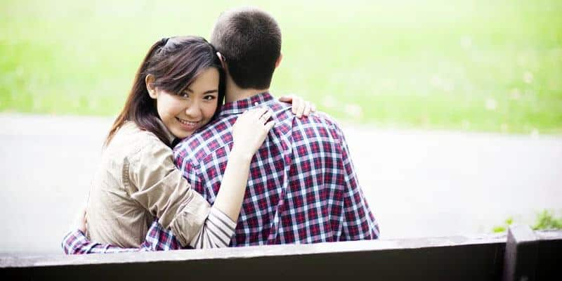 cute and sweet Asian girl hugging her partner