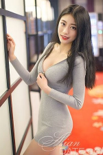 easy going Chinese woman in sexy gray dress