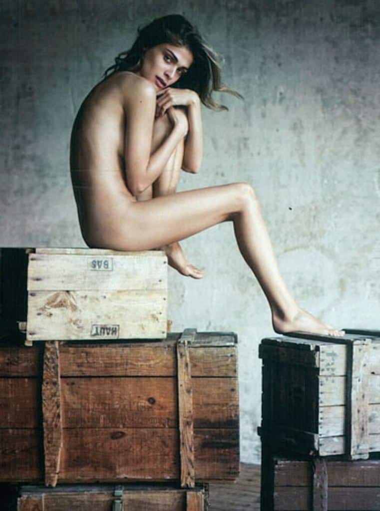 Elisa Sednaoui nude sitting on a crate