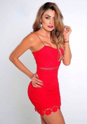 sexy and hot Colombian in a short red dress