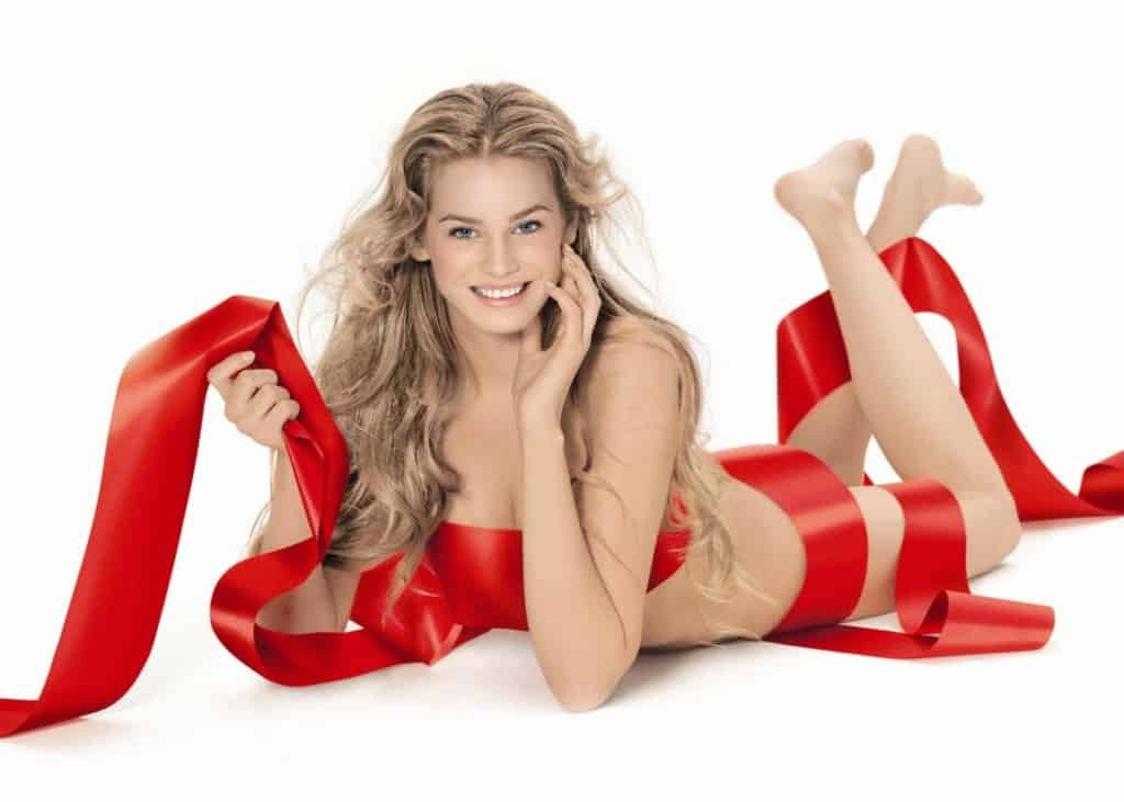 Vanessa Hessler wearing only a red ribbon