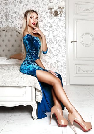 blonde Ukrainian girl on the bed