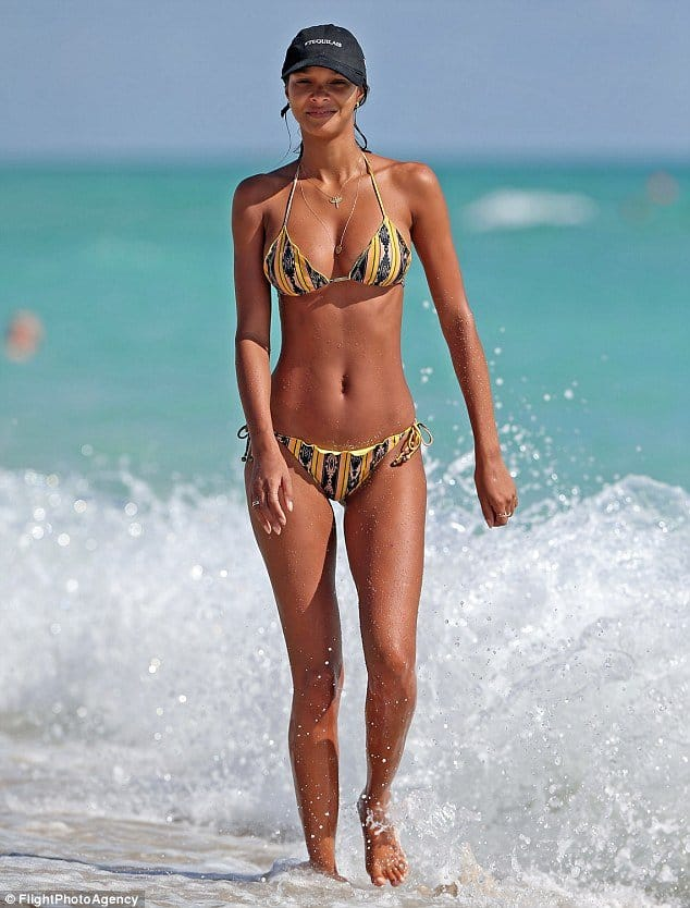 Lais Ribeiro looking cool and having fun at the beach
