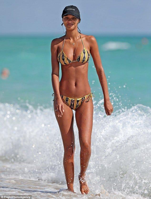 Lais Ribeiro looking cool and having fun at the beach
