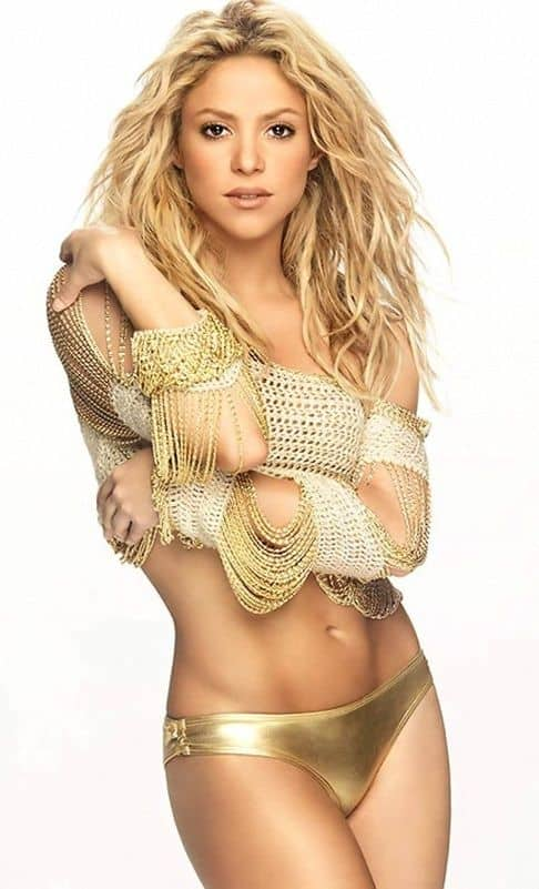 Shakira glowing in gold